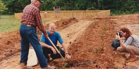 Gene Strowd and past board member, Edward Norfleet transplant some of Gene's personal rose bushes into the Gene Strowd Community Rose Garden.