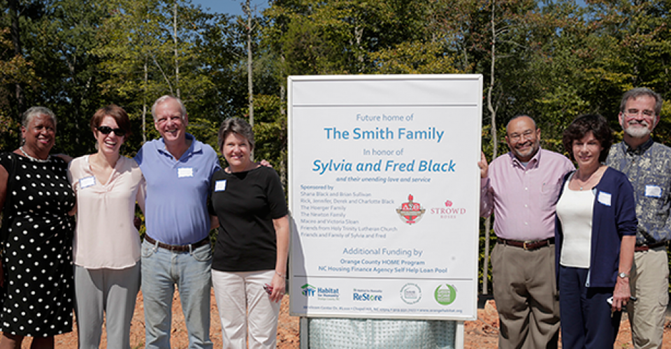 Past and present board members and staff attend a Habitat for Humanity of Orange County groundbreaking for a home in honor of Sylvia and Fred Black.